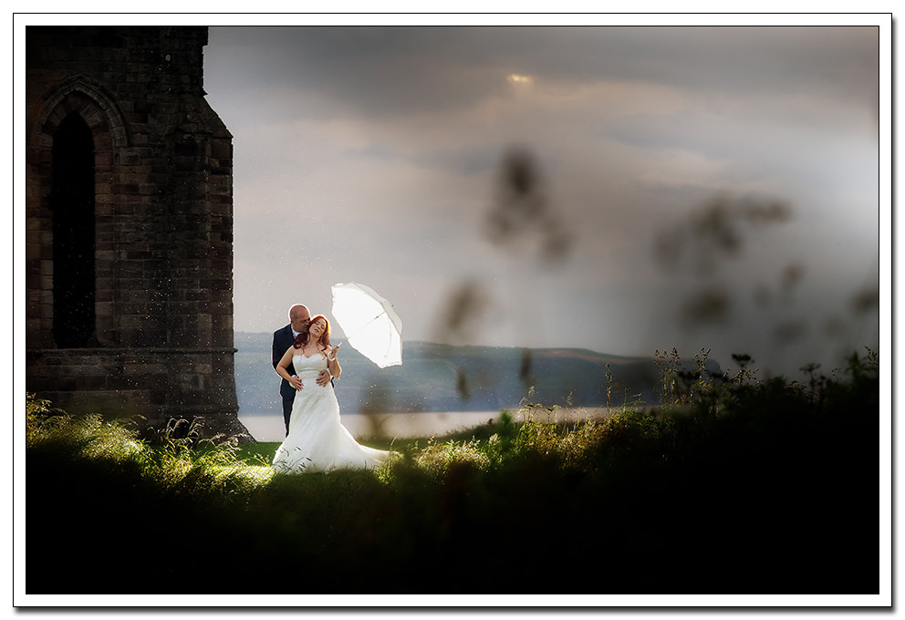 bride and groom at whitby abbey