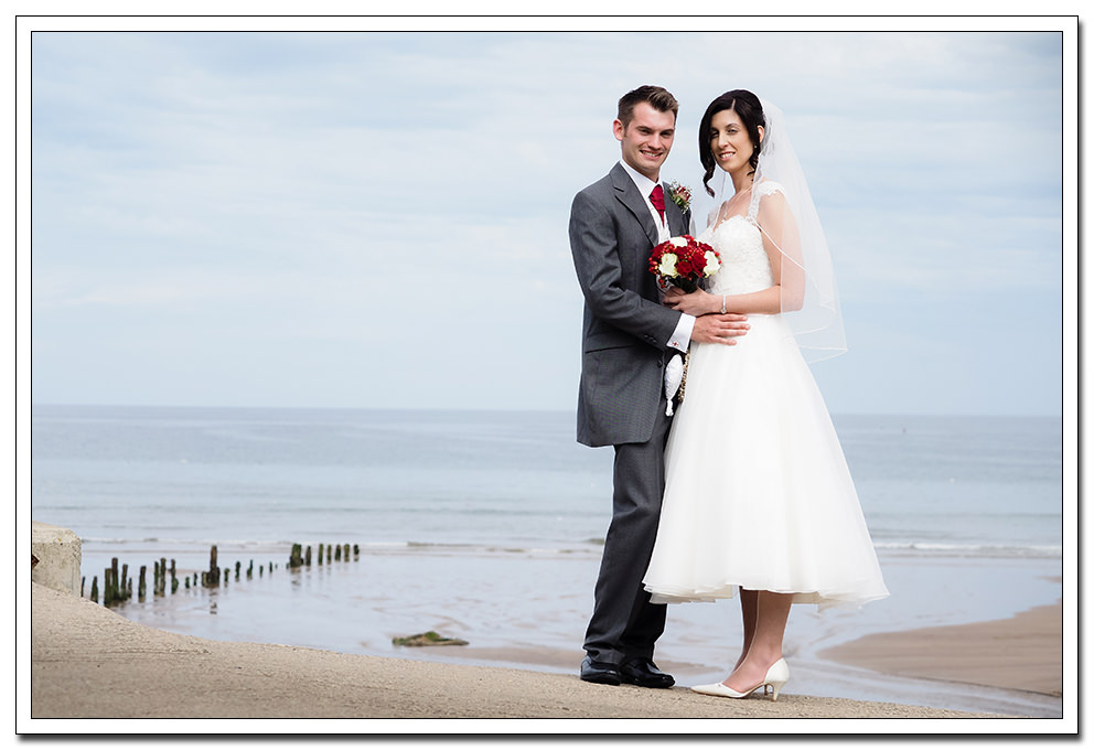 bride and groom portrait in sandsend