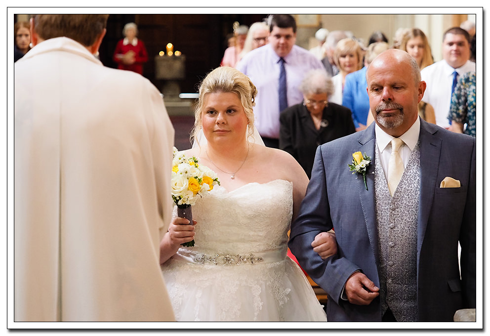 bride and father at st peters church norton