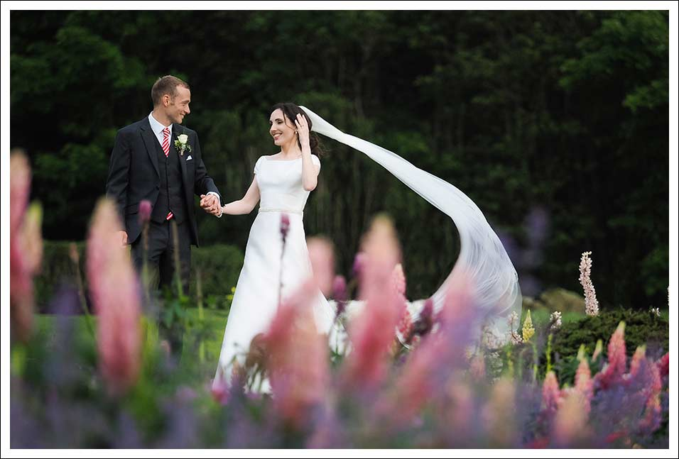 bride and groom portrait on the grounds of ravenhall