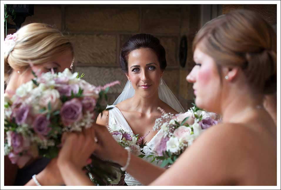 bride and bridesmaids at crossbutts stables, whitby