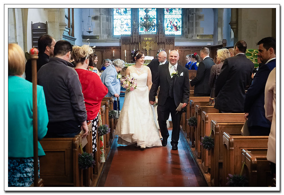 bride and groom exiting the church