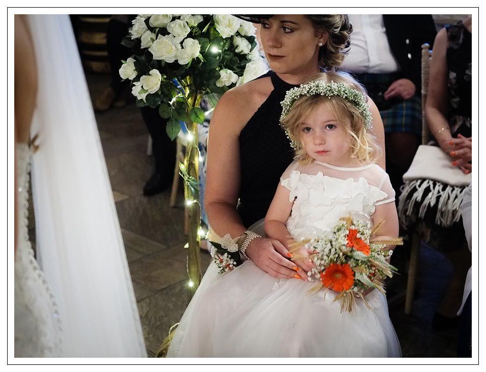 flowergirl at the ceremony in crossbutts