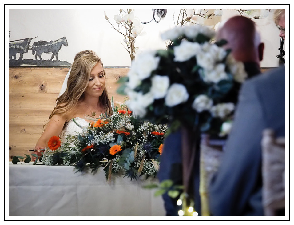 the bride signing the register at crossbutts stables