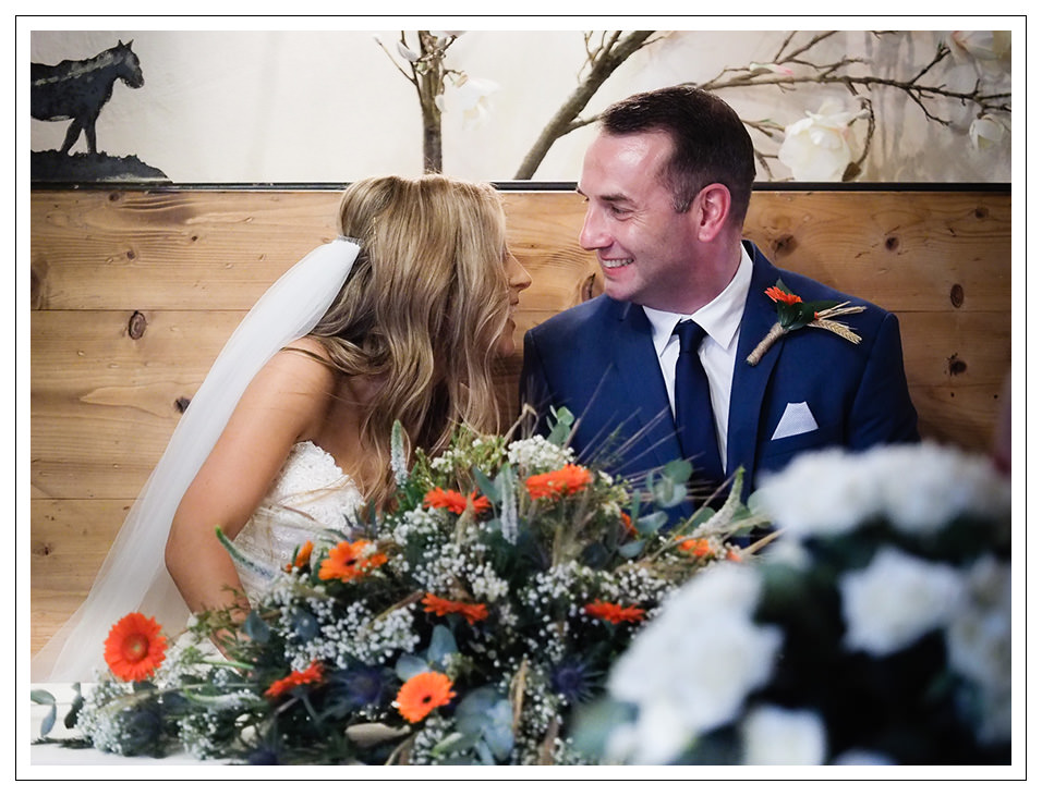 bride and groom during the signing of the register at the stables in whitby