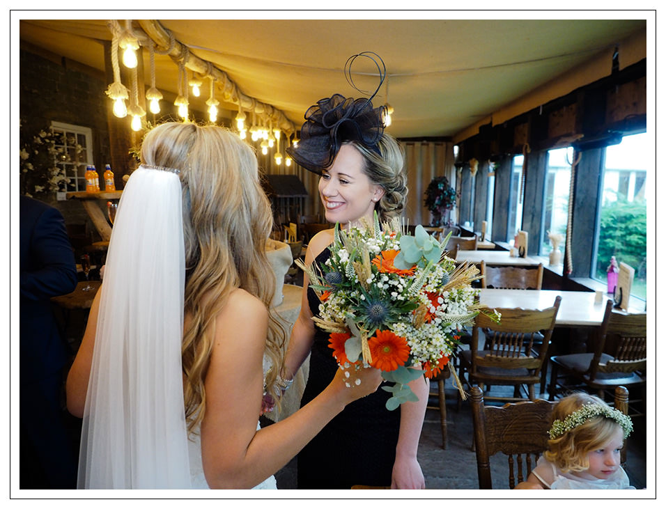 guests congratulating the bride at crossbutts stables
