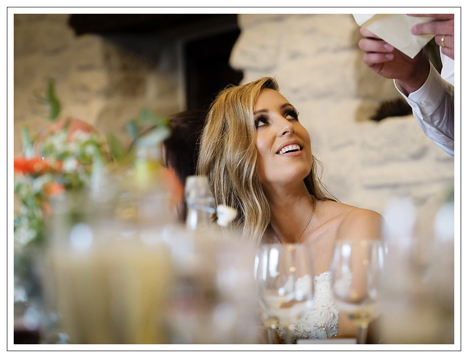 bride during the best mans speech at the stables in whitby