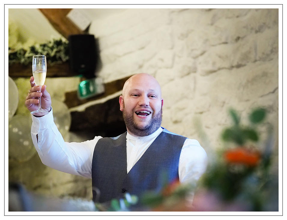 the best man toasting the bride and groom