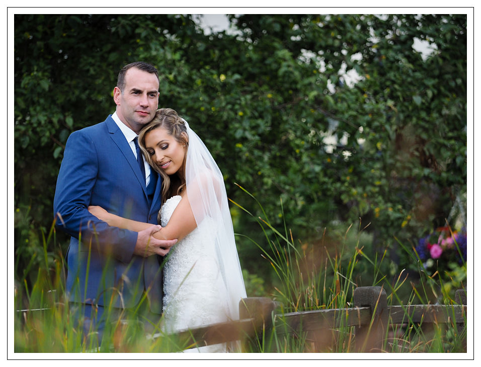 bride and groom portrait at crossbutts stables in whitby