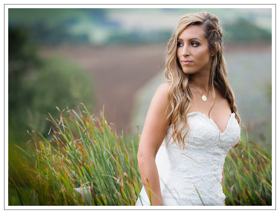 bride portrait taken after the ceremony in the grounds of crossbutts stables in whitby