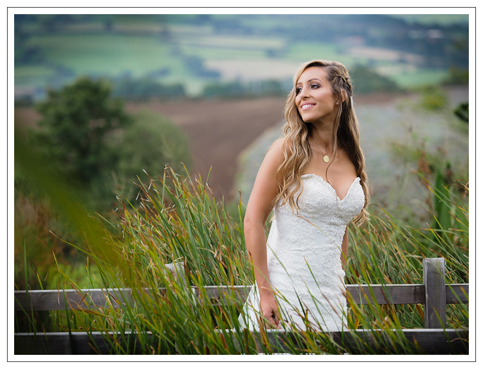 wedding at crossbutts stables - bride portrait taken after the ceremony in the grounds of crossbutts stables in whitby