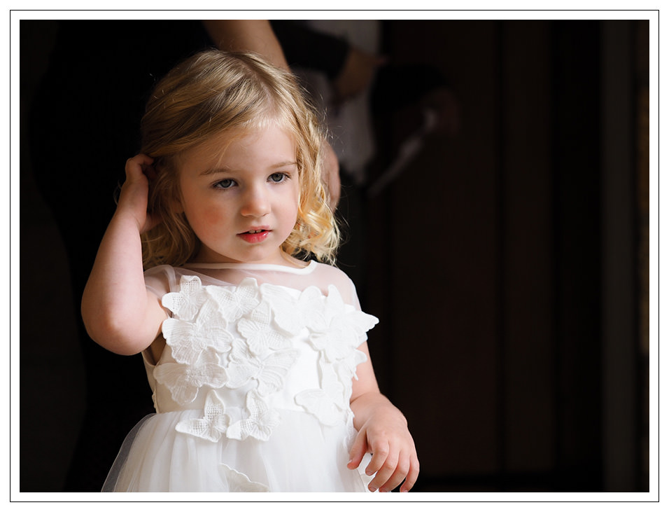 flowergirl waiting for the bride at crosbutts stables in whitby