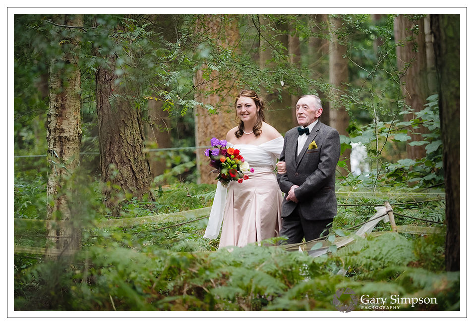the walk through the woods for bride and her father at camp katur