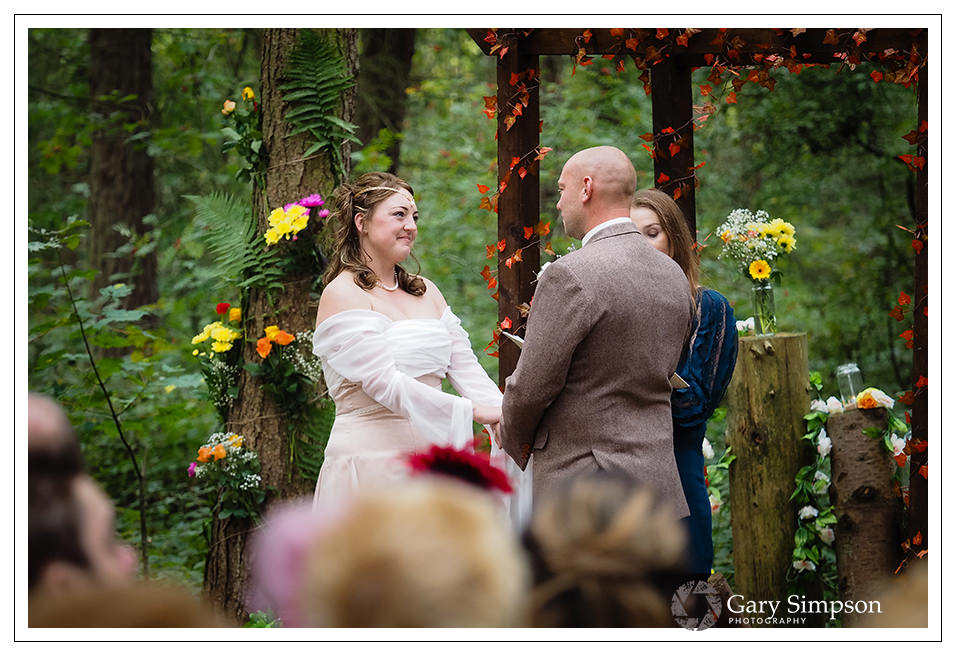 wedding ceremony in the woods of camp katur