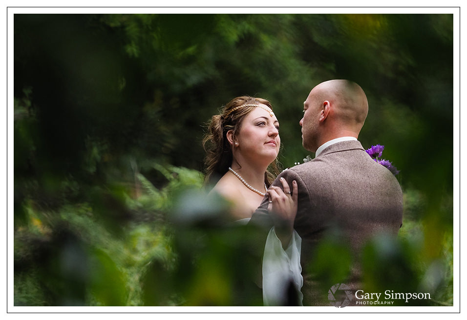 bride and groom portrait in the woods of camp katur