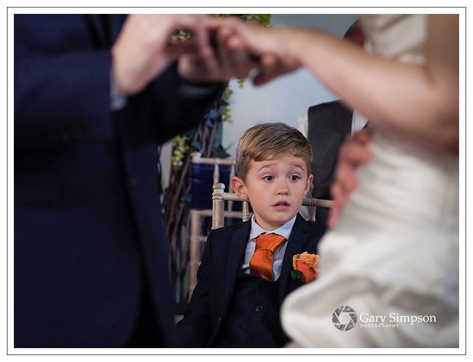 page boy during the wedding vows at crossbutts stables, whitby