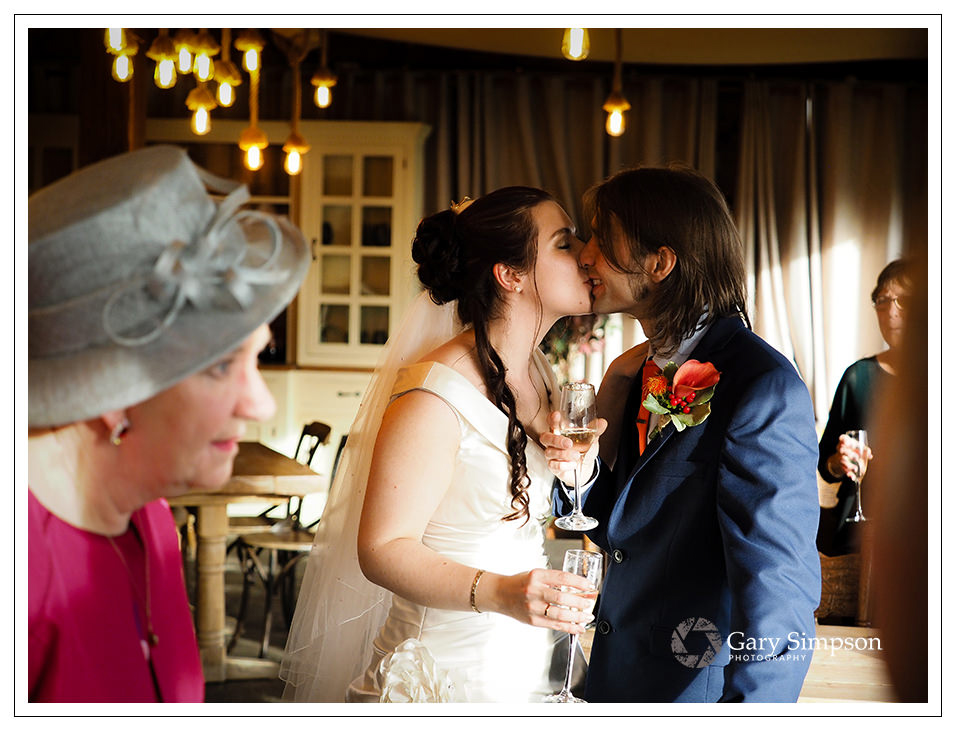 bride and groom share a kiss at crossbutts