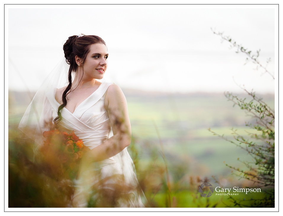 crossbutts wedding photography - bridal portrait in the gardens of crossbutts stables in whitby