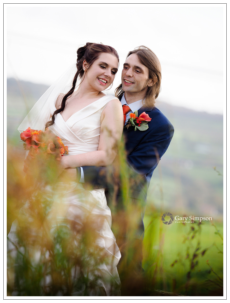 bride and groom portrait in the grounds of crossbutts stables in whitby