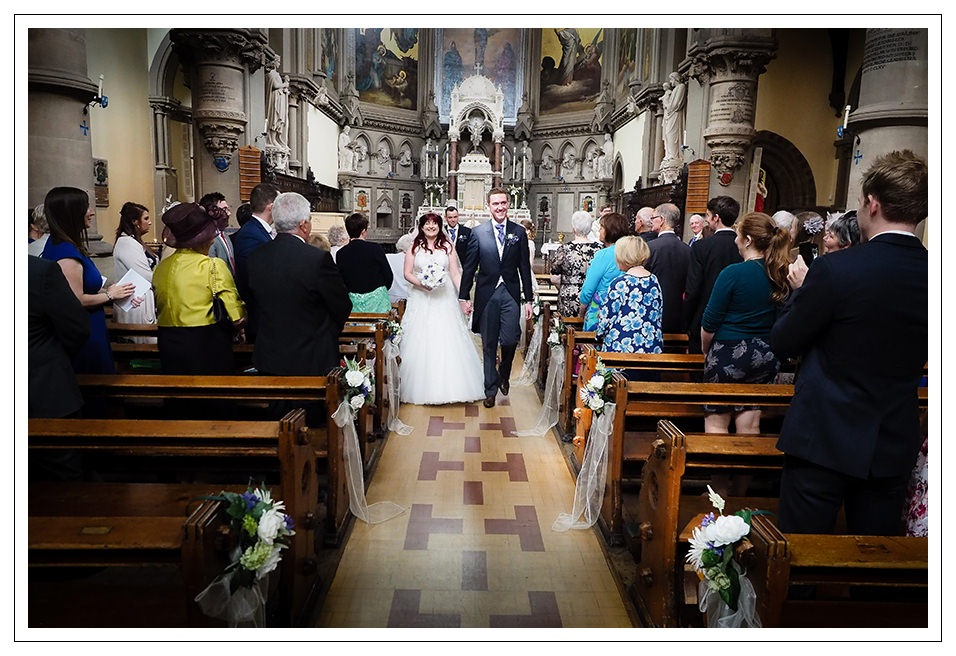 Leaving the church as husband & Wife at St Wilfreds Church in York
