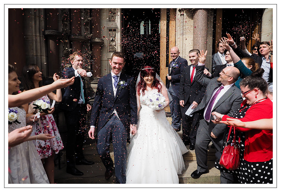 Confetti for the newly married couple outside St Wilfred's roman Catholic church