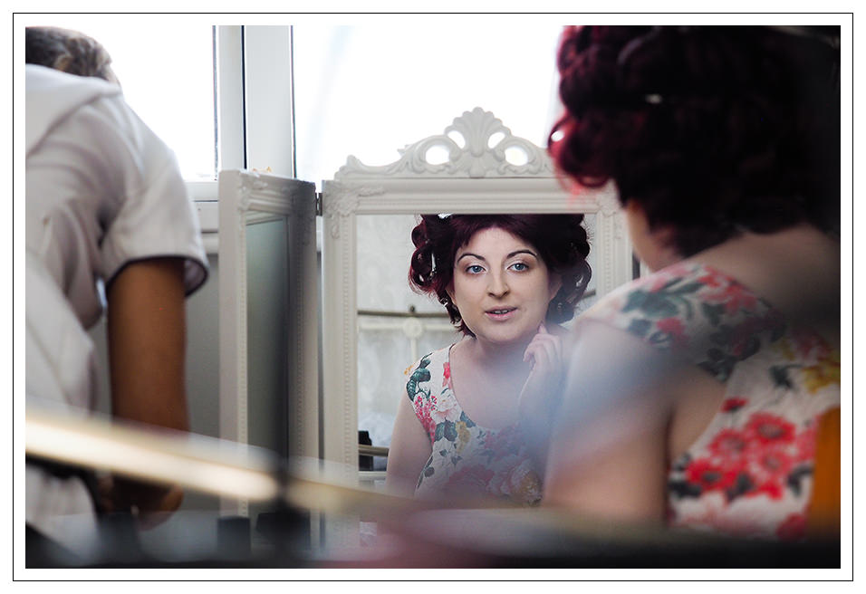 reflection of the bride during the hair and make