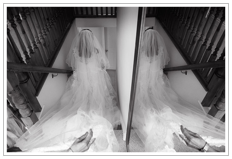 the bride leaving home for the ceremony and reflected in the mirror