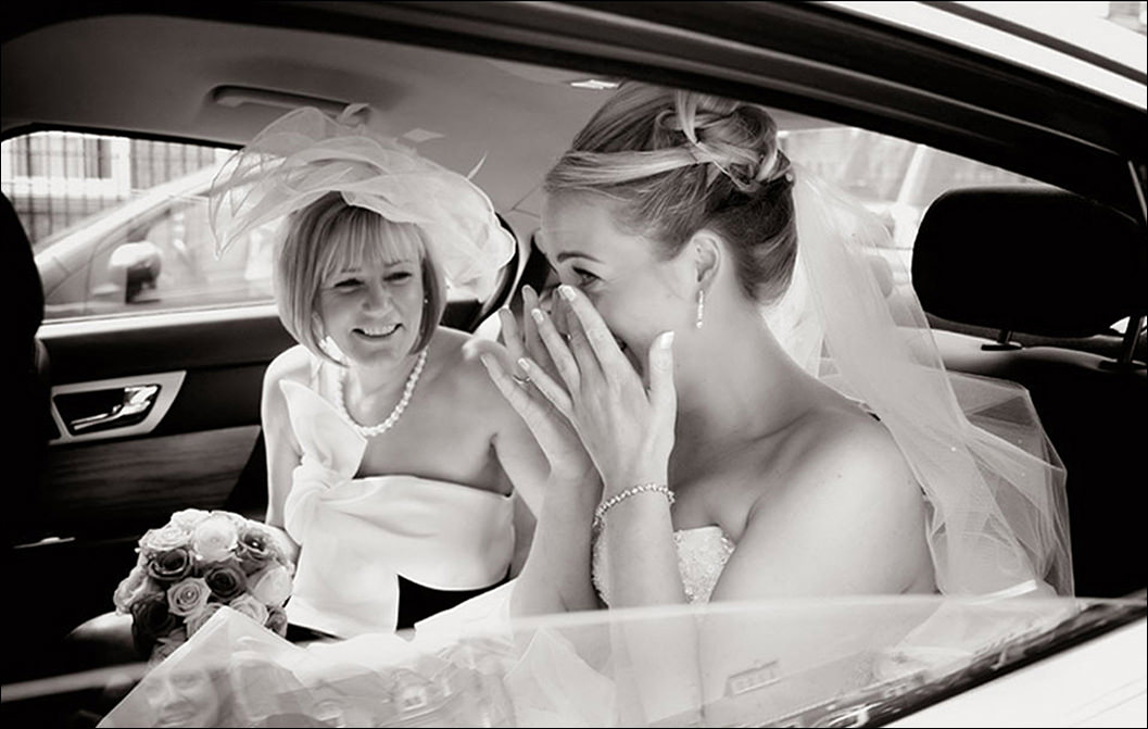 bride with her mother arriving at church