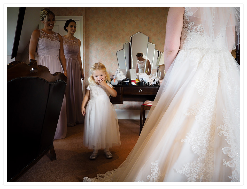 flowergirl with bridesmaids and bride