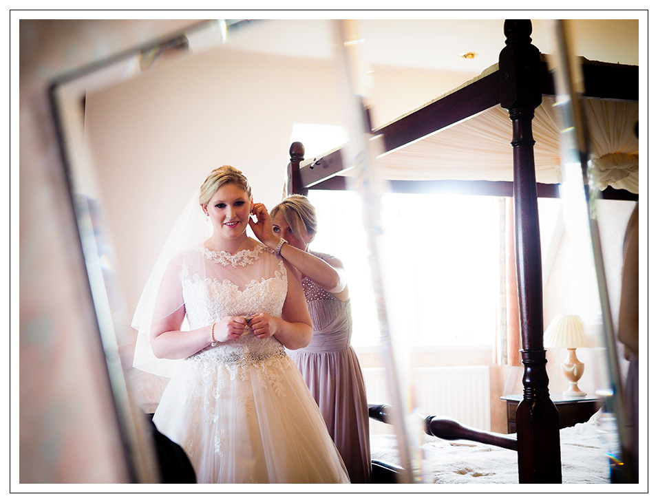 bride with her final touches at rushpool hall hotel