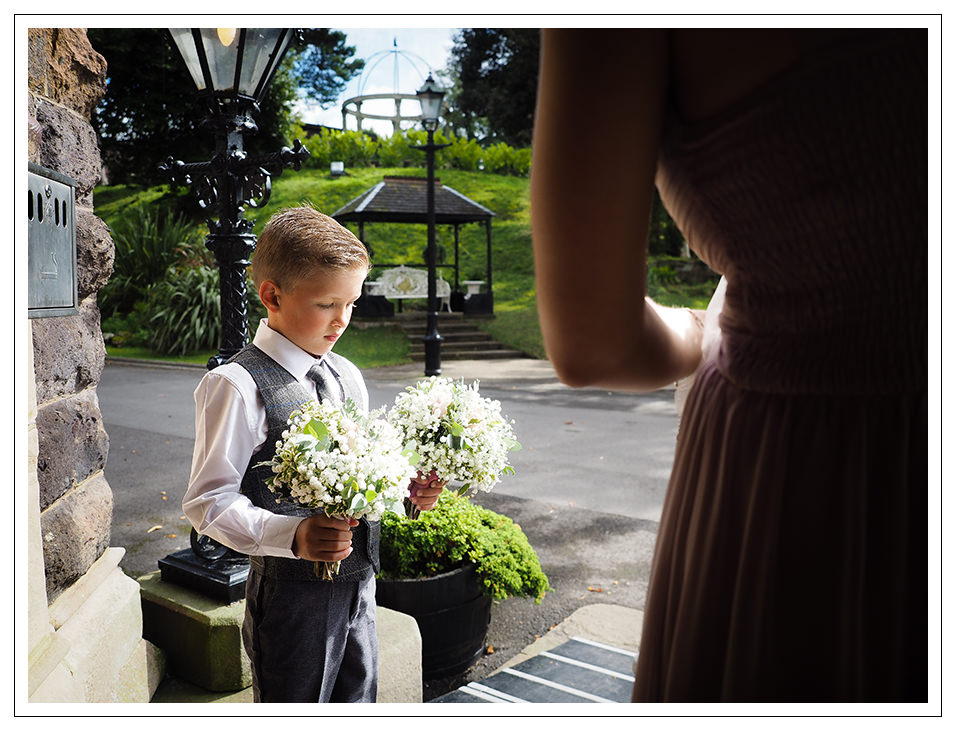 page boy waiting for bride and bridesmaids