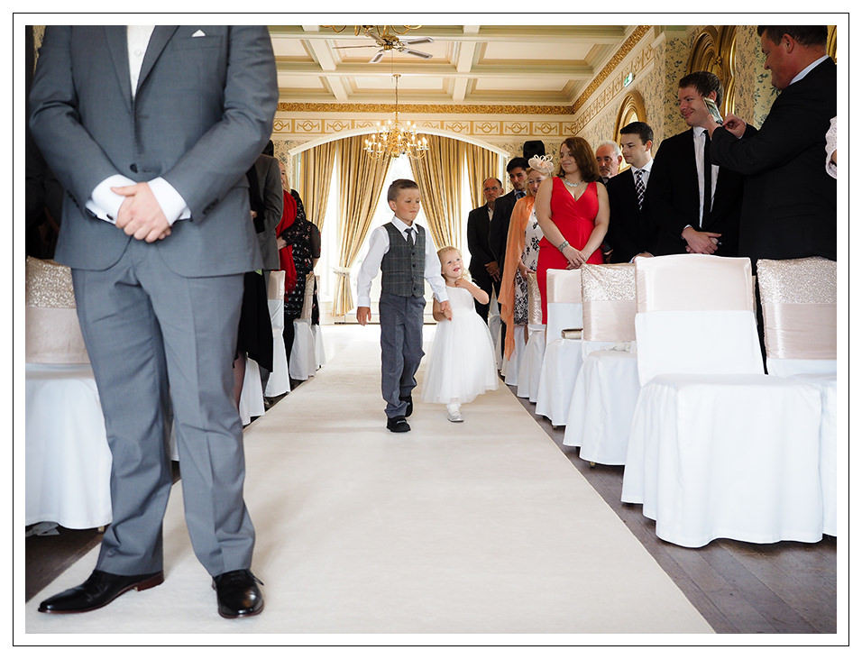 pageboy and flowergirl entering the ceremony at rushpool hall hotel