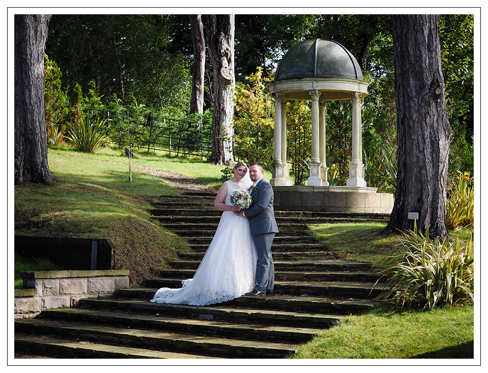 bride and groom portrait in the grounds of rushpool hall
