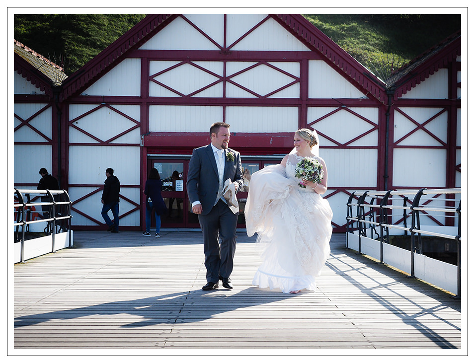 bride and groom on saltburn pier