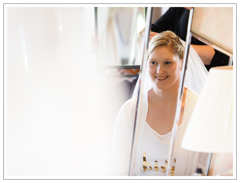 reflection of the bride during the bridal prep