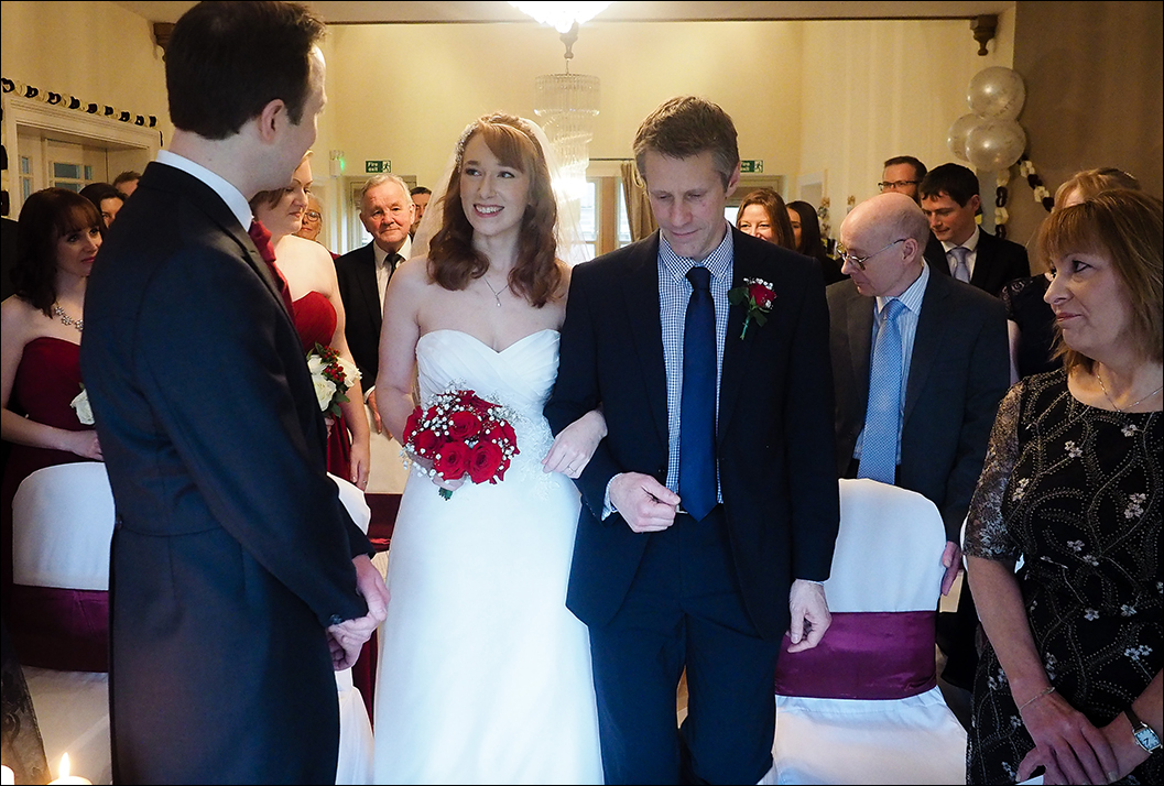 bride entering the ceremony at the lakehouse at raithwaite hall