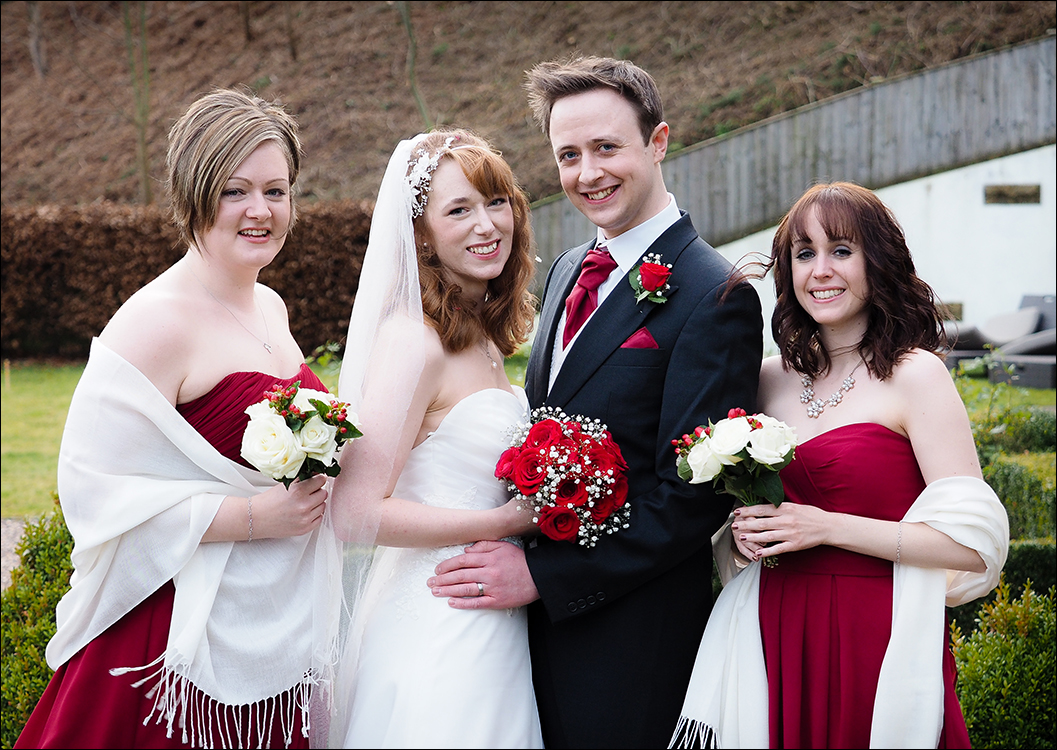 bride & groom and bridesmaids outside the Lakehouse at Raithwaite Hall