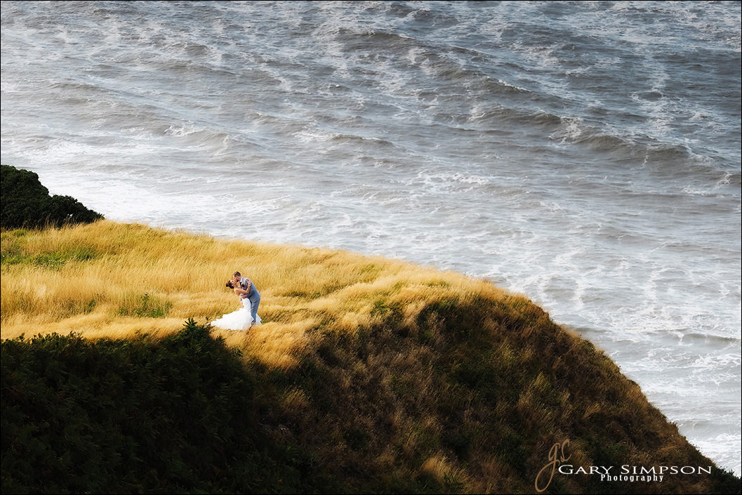 on the cliffs of ravenhall, bride and groom picture