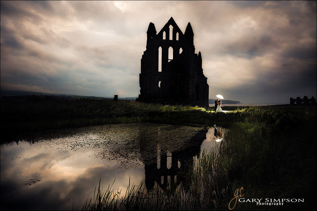 bride and groom on a late evening at whitby abbey
