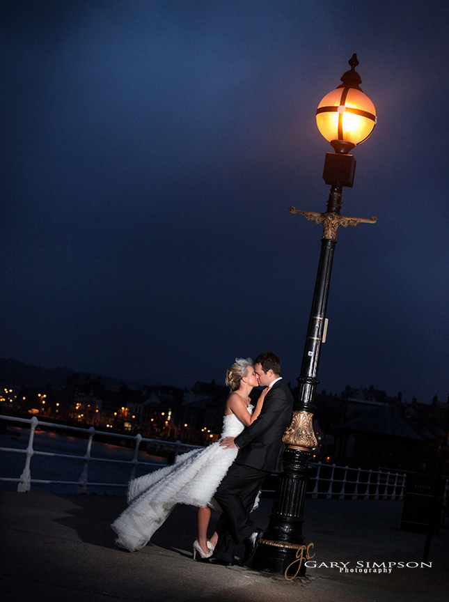 bride and groom on whitby pier