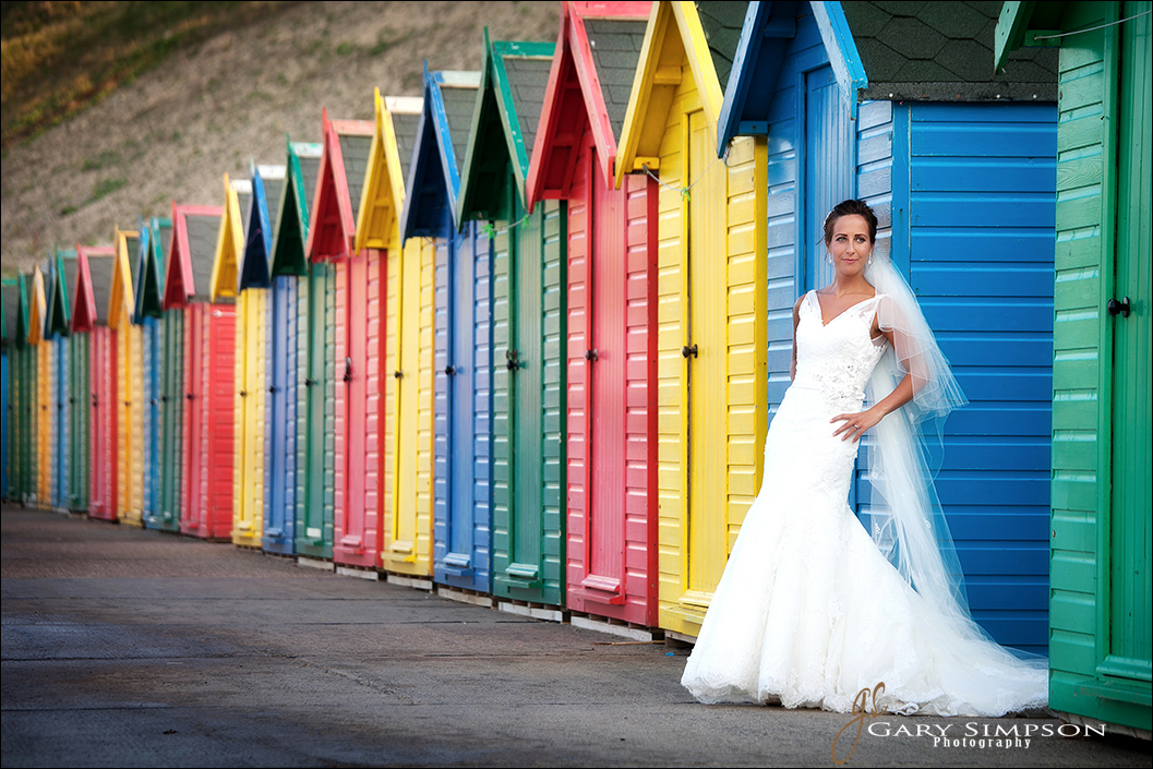 bride portrait on whitby front with the beach huts