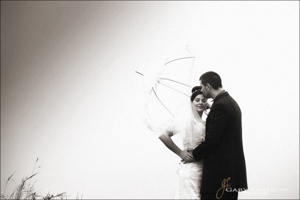 bride and groom on a misty day at the hole of horcum