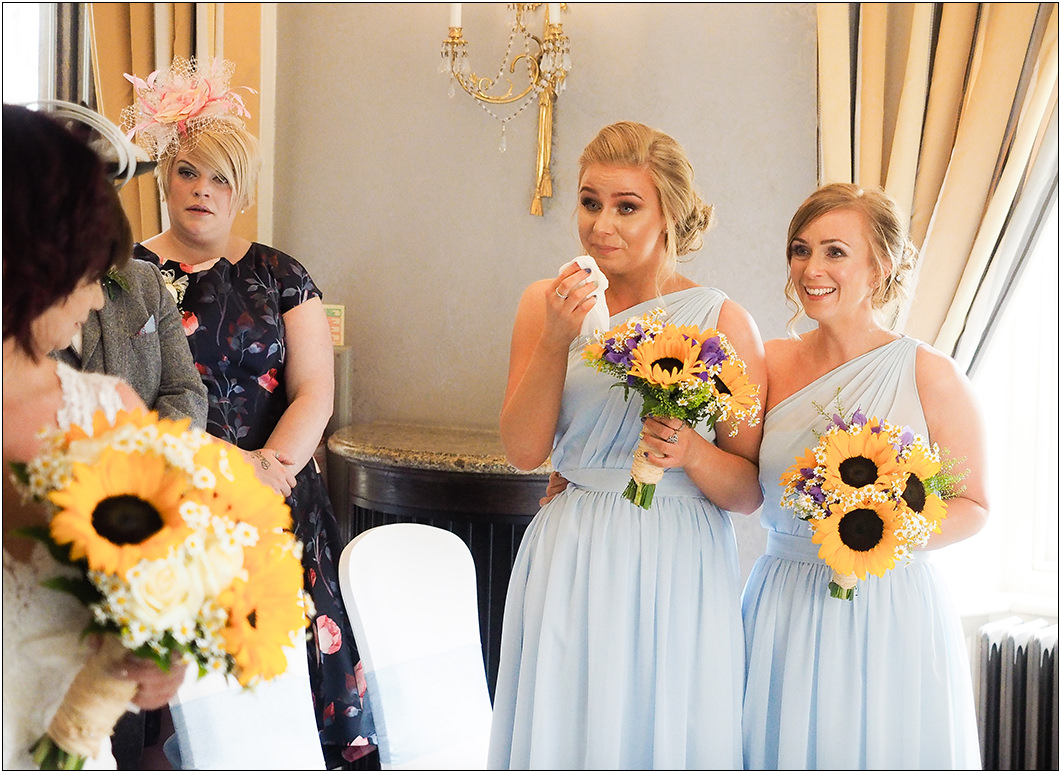 emotional bridesmaids during the wedding ceremony at oulton hall