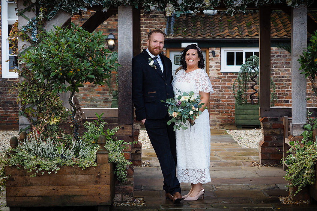 bride & groom and a confetti shower at raithwaite hall
