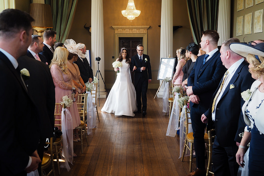 bride and father entering for the wedding ceremony at howsham hall