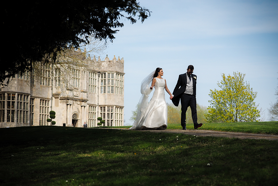 bride and groom walking through the grounds of howsham hall