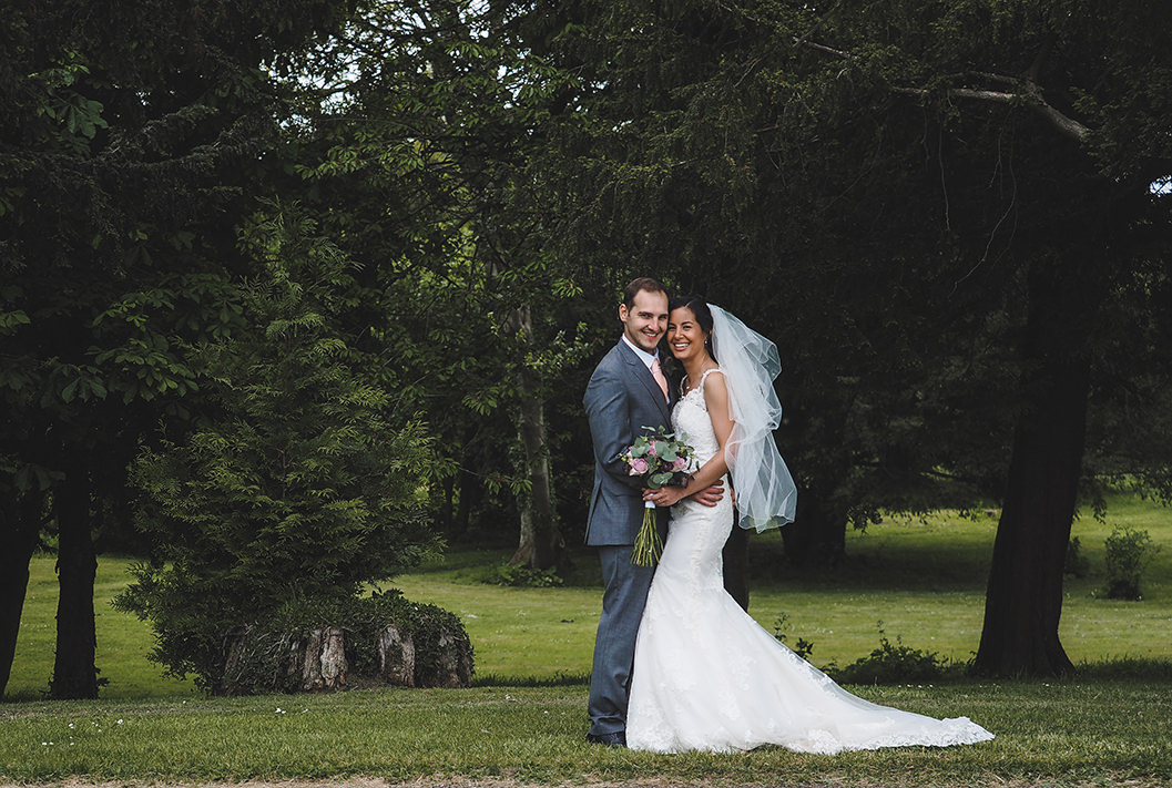bride and groom image together in the grounds of howsham hall in yorkshire