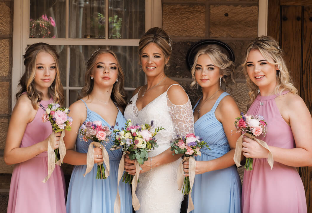 bride and bridesmaid portrait at crossbutts stables, whitby