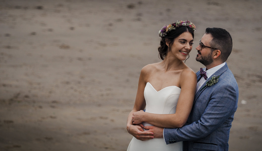 bride and groom portrait on the beach of whitby